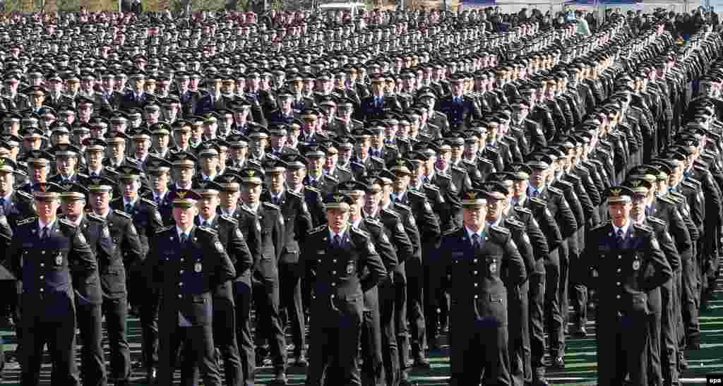 Graduates of the National Central Police Academy attend their graduation ceremony at the school in Chungju, South Korea. (epa/Yonhap)