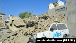 The site of a suicide bomb attack near a building used by the Office of the United Nations High Commissioner for Refugees (UNHCR) in Kandahar on October 31.