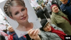 A Ukrainian opposition supporter holds aloft a portrait of jailed ex-Prime Minister Yulia Tymoshenko during a protest in Kyiv last month.