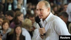 Vladimir Putin answers questions from the audience during his visit to the summer camp of the pro-Kremlin youth group Nashi at Lake Seliger on August 1.