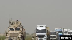 Iraq -- A US armored vehicle escorts a 19-truck convoy through a northern Iraqi region, 04Sep2010
