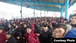 Workers on strike gather in Zhanaozen to demand higher wages.