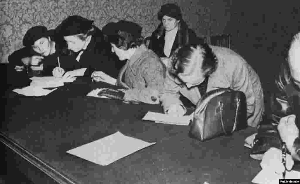 Czechs expelled from the Sudetenland fill out a questionnaire for refugees in Prague on October 13, 1938. The territory annexed by Germany contained over 3 million Germans and 750,000 Czechs.