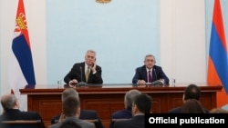 Armenia - President Serzh Sarkisian (R) and his visiting Serbian counterpart Tomislav Nikolic address the press after talks in Yerevan, 12Oct2014.