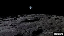 "The Earth rises over the Moon's surface in this still from a camera onboard Japan's ""Kaguya"" lunar probe."