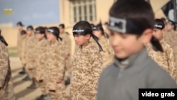 "A screen capture from the nine-minute IS video titled Al Farouq Training Camp for Cubs, a term used by militants to describe young ""jihadis"""