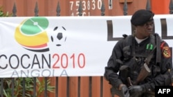 A Congolese policeman stands guard outside players' quarters in Cabinda.
