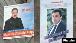Armenia -- Election campaign posters of Hrazdan Mayor Aram Danielian (R) and his opposition challenger Sasun Mikaelian, 10Feb2012.