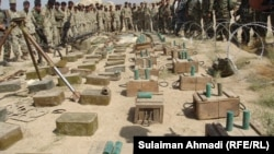 Afghan military forces discover large amount of ammunitions from Baghlan province 24Sep2011