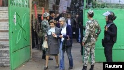 Voters at a polling station to cast ballots during the parliamentary elections in Cairo on November 29.