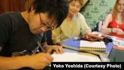 "The Japanese Embassy in Minsk would only tell RFE/RL that it was taking ""all necessary and possible measures"" to free artist Daichi Yoshida, shown here in an undated photo."