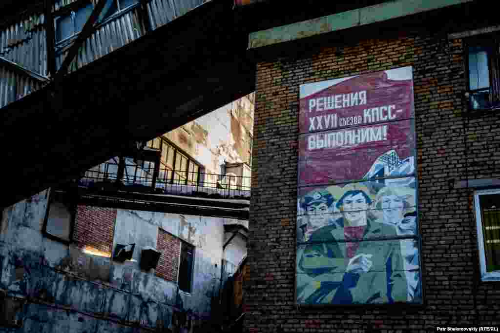 A Soviet-era poster still adorns a wall near the Severnaya coal mine.