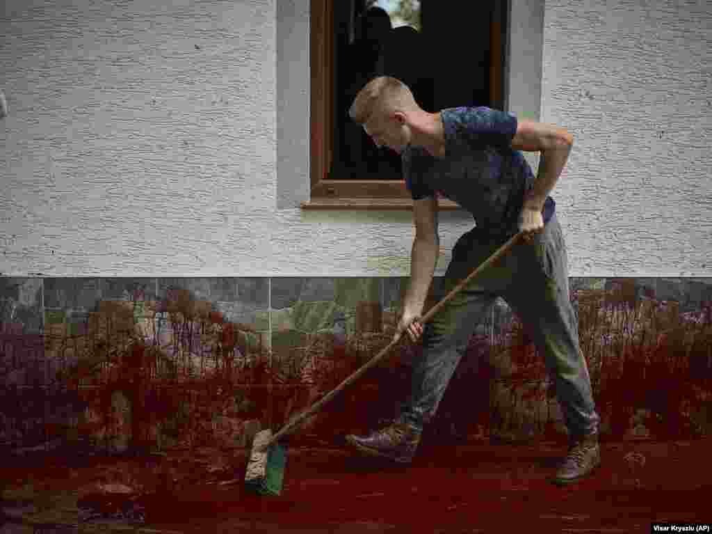 A man cleans the blood of sacrificed sheep during the traditional feast celebration marking St. George's Day in the village of Babaj i Bokes, western Kosovo. (AP/Visar Kryeziu)