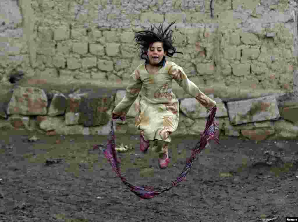 An internally displaced Afghan girl plays near her shelter at a refugee camp in Kabul. (Reuters/Omar Sobhani)