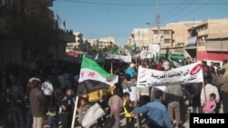 Syrian demonstrators protest against the regime in Al-Baidah, near Homs, last month.