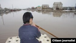 Оралдағы су тасқыны кезінде. (Көрнекі сурет)