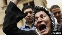 Єгипетські копти-християни протестують проти дій ісламістів і президента Мухаммада Мурсі перед храмом святого Марка в Каїрі, 8 квітня 2013 року