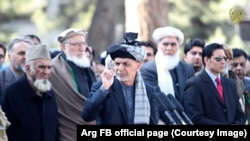 Afghan President Ashraf Ghani (C) during a press conference on February 2