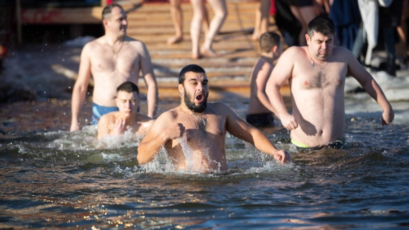 Orthodox Believers Swim In Icy Waters On Epiphany