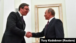 Russian President Vladimir Putin (right) meets with his Serbian counterpart, Aleksandar Vucic, at the Kremlin in Moscow on October 2.