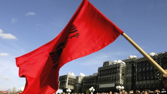 A Kosovar Albanian waves the Albanian flag during a protest against deployment of the EU mission in Pristina ealier this month.