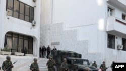 Soldiers standing guard in downtown Tunis