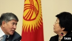 President Roza Otunbaeva (right) believes Prime Minister Almazbek Atambaev's government can survive Kyrgyzstan's traditionally turbulent spring.