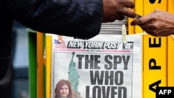 A New York newspaper features a personal photo of suspected Russian spy Anna Chapman at a newsstand in New York in June during the trial of the 10 accused.