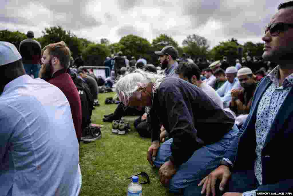 "Mohammed Nadir, 58, cries he listens to a service for twin mosque massacre victims in a park near the Al Noor Mosque in Christchurch, New Zealand on March 22. Nadir's brother Haji Mohammed Daoud Nabi, 71, was the first victim of the Al Noor Mosque massacre and was shot after welcoming the gunman into the building with the words ""Hello, brother."" (AFP/Anthony Wallace)"