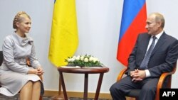 Russian Prime Minister Vladimir Putin meets with his Ukrainian counterpart, Yulia Tymoshenko, in Gdansk on September 1.