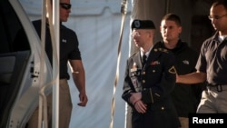 U.S. Private First Class Bradley Manning is escorted out of court after testifying in the sentencing phase of his military trial at Fort Meade, Maryland, on August 14.