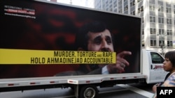 A truck displaying posters protesting against Iranian President Mahmud Ahmadinejad near the UN building in New York in September 2009