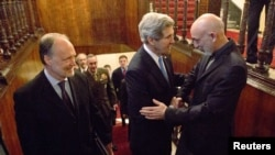 Afghan President Hamid Karzai (right) met with U.S. Secretary of State John Kerry (middle) and U.S. Ambassador to Afghanistan James Cunningham in Kabul on March 25.