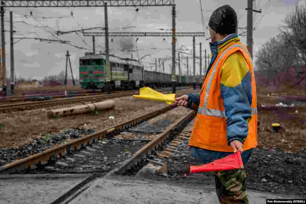A worker at a railroad crossing