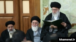 FILE photo - Iran's Supreme Leader Ali Khamenei with his close supporter Ahmad Alamolhoda (C).