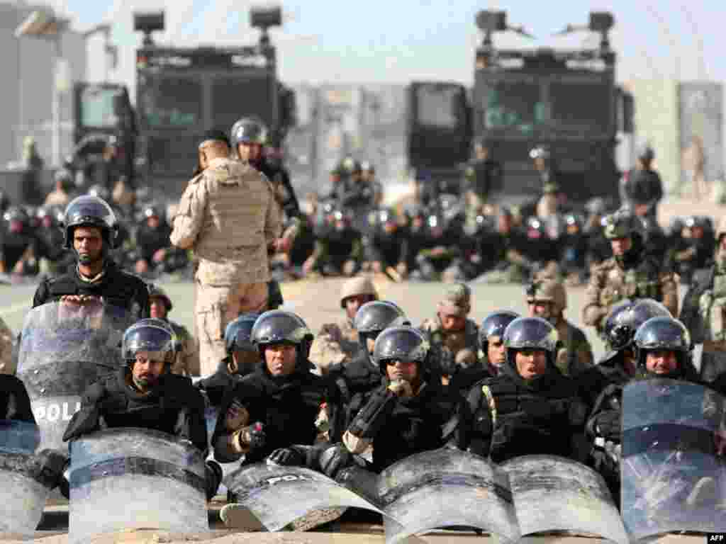 "Iraqi riot police block streets in the capital, Baghdad, during another ""Day of Rage"" on March 4. Photo by Ahmad al-Rubaye for Reuters"