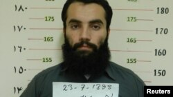 Afghanistan -- Anas Haqqani, a senior leader of the Haqqani network, arrested by the Afghan Intelligence Service (NDS) in Khost province is seen in this handout picture released October 16, 2014.