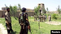 Afghan militias and policemen gather during a battle in Kunduz on May 3.