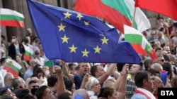 Waving EU and Bulgarian flags, anti-government protesters rally in Sofia on July 14.