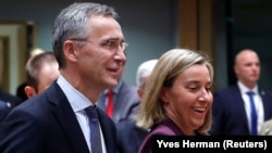 NATO Secretary-General Jens Stoltenberg (left) and European Union foreign policy Chief Federica Mogherini (file photo)