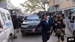 Pakistani security forces outside a court in Islamabad.