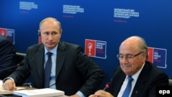 Президент ФИФА Йозеф Блаттер с президентом России Владимиром Путиным, октябрь 2014 года