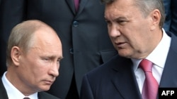 Putin and Yanukovych pictured in Kyiv in July 2013.