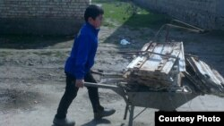 Uzbekistan - school boy is bringing a scrap metal to the school in Jizzakh city, 14 March 2015