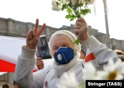 A woman takes part in a march by pensioners in Minsk on October 26.