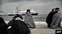 Children wrapped in blankets stand in a harbor as migrants and refugees arrive on the Greek island of Lesbos while crossing the Aegean Sea from Turkey earlier this month. Hundreds if thousands of migrants have made a similar journey from Turkey, which is struggling to host 2.7 million registered refugees from Syria, plus an unknown number of unregistered refugees. (file photo)