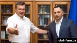 The former Ukrainian parliamentarian who disclosed the personal information, Andriy Portnov (right), used to serve as chief of staff to ex-President Viktor Yanukovych (left).