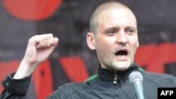 Left Front leader Sergei Udaltsov speaks at an opposition rally in Moscow in June 2012.
