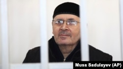 Oyub Titiyev, the head of a regional branch of Russian human rights group Memorial, attends a court hearing on drugs charges in Grozny on March 6. Titiyev says the charges are fabricated in an effort to run the respected rights organization out of Chechnya.