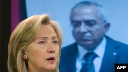 U.S. Secretary of State Hillary Clinton speaks alongside Palestinian Prime Minister Salam Fayyad in Washington.